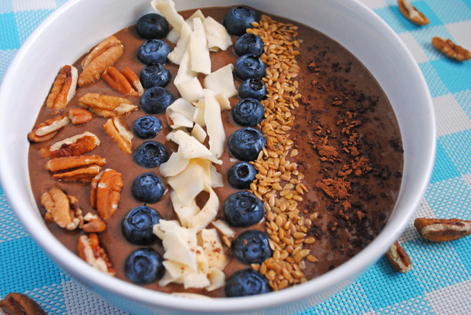 chocolate smoothie bowl on blue tablecloth