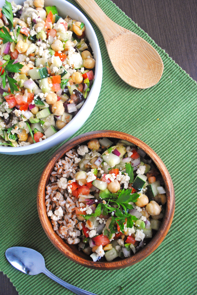 Packed with veggies and fresh Greek flavors, this chickpea salad with tangy vegan almond feta makes a quick, nutritious dinner perfect for lunch leftovers!
