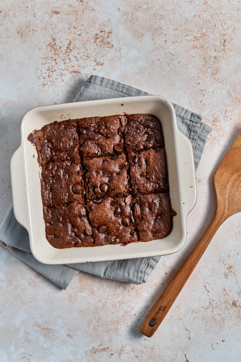 a dish of almond butter chocolate chip blondies cut into squares