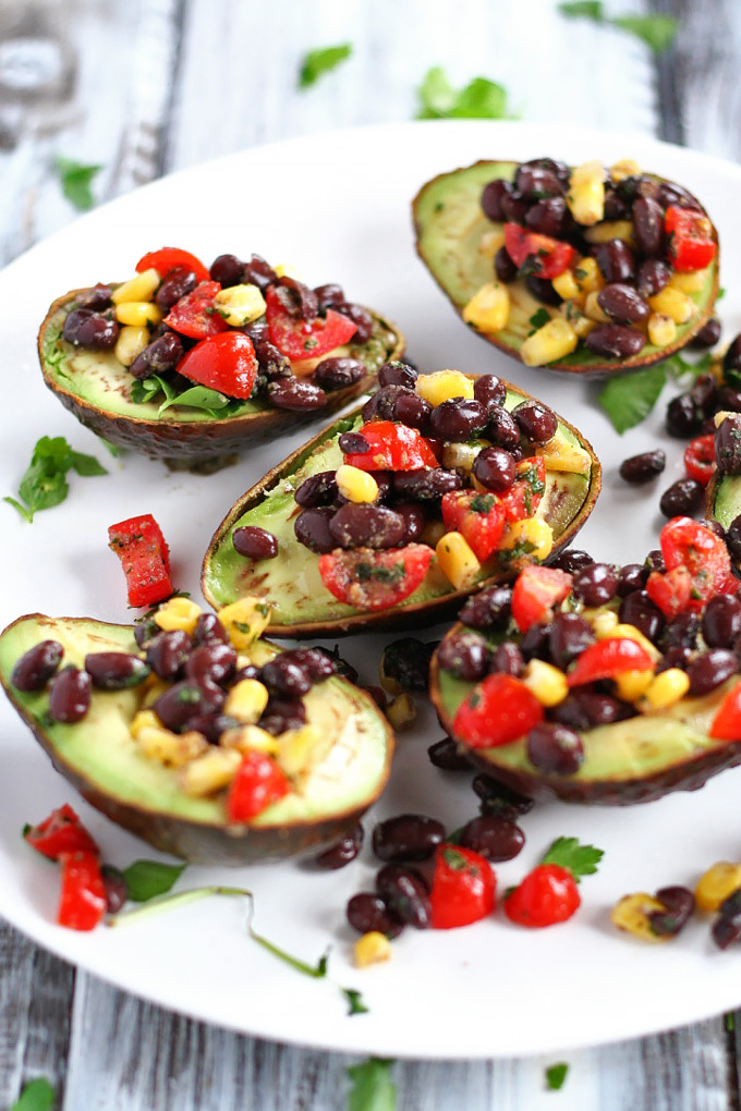 Looking for a healthy party appetizer? This Mexican Stuffed Avocado with Buffalo Tahini Sauce recipe is the perfect one to cook for any gathering.