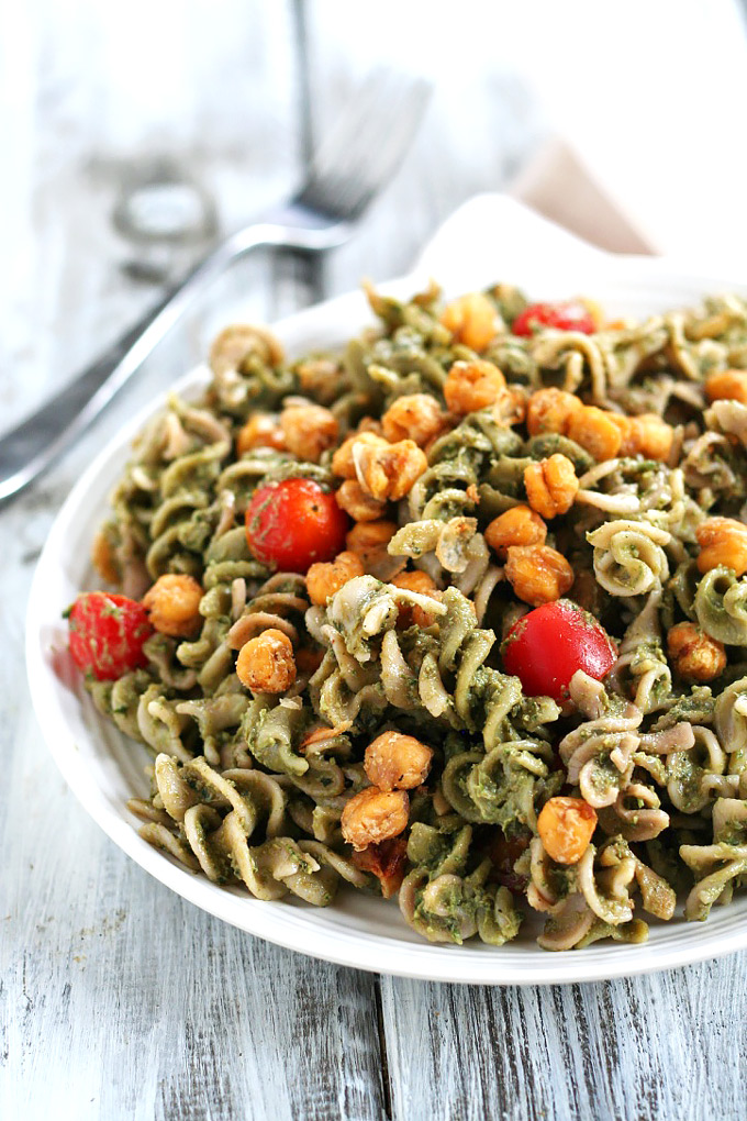 Looking for a dinner that's done in under one hour? This Avocado Pesto Pasta is creamy and satisfying, and the roasted chickpeas take it to the next level.