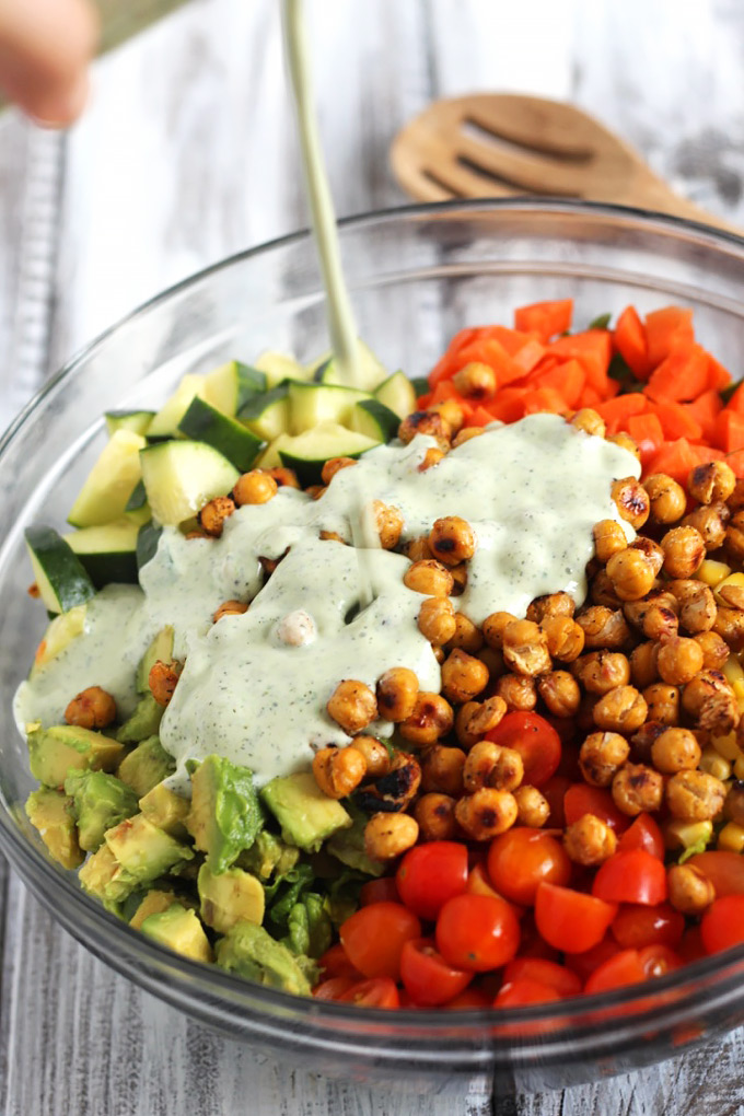 This Roasted Chickpea Salad is packed with nutritious vegetables and protein, perfect for an on-the-go lunch. The vegan ranch dressing is so flavorful!
