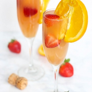 Enjoy this gut-friendly sparkling drink at your next party or brunch! A Strawberry Kombucha Mimosa is a great way to keep happy hour healthy.