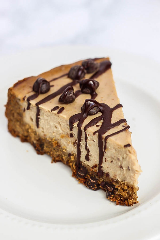 This Vegan Cheesecake with Chocolate Chip Cookie Crust is unbelievably creamy & tastes like the real thing, without dairy. A combination of two classics!