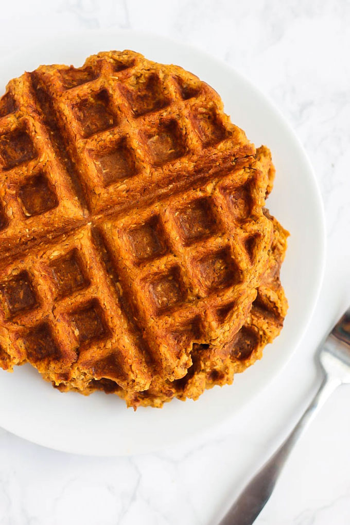 Add some vegetables to your breakfast routine with these decadent Sweet Potato Waffles with Blueberry Sauce! Vegan, gluten-free, and made in the blender.