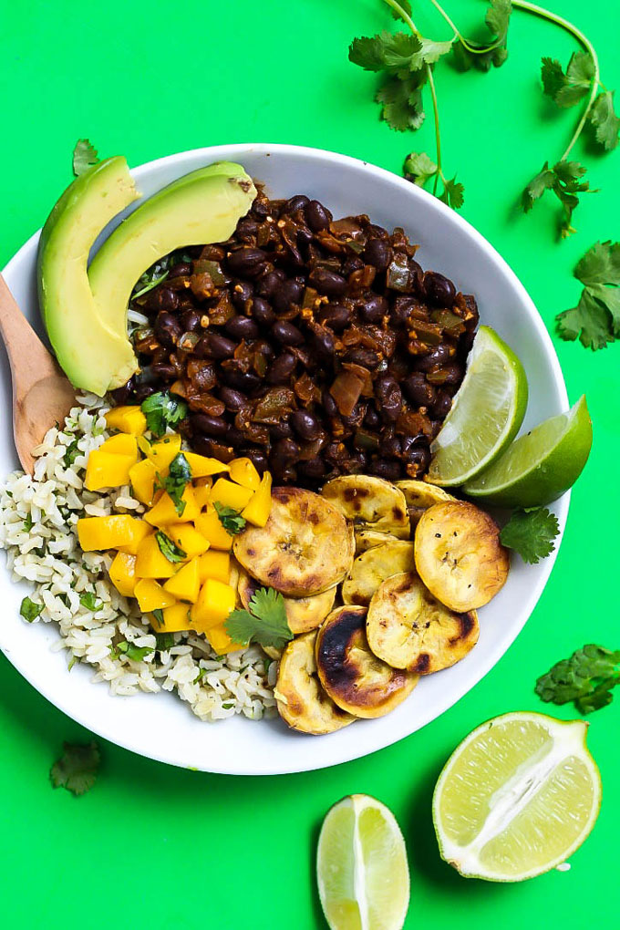 With a little heat and lots of flavor, these Black Bean Cilantro Lime Rice Bowls with Plantains make a healthy dinner or lunch recipe! Your burrito bowl night just got a whole lot better. V + GF.