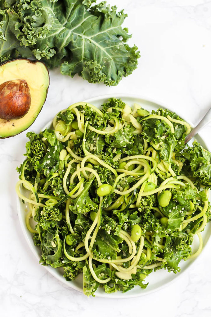 Feed your body all the healthy green things with this vegan Green Goddess Avocado Kale Salad with edamame & zucchini! You'll be glowing from the inside out.