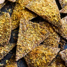 Enjoy the cheesy, crispy snack you love in a healthier way by making these Easy Baked Vegan Doritos! They're a great flavorful snack or party finger food.