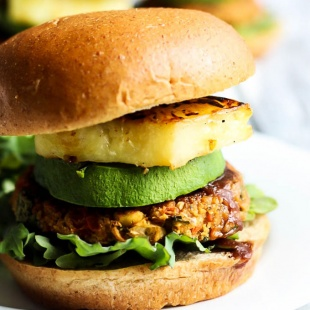 These Hawaiian Chickpea Veggie Burgers are healthy, satisfying & packed with vegetables! Enjoy with grilled pineapple & BBQ sauce for an epic vegan burger.
