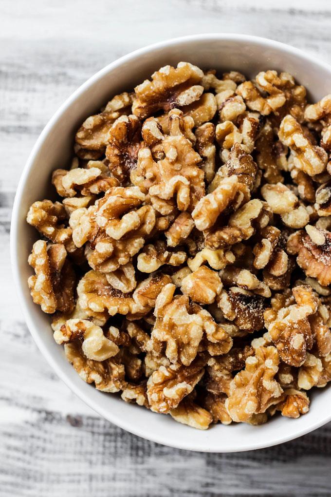 a bowl of raw walnuts
