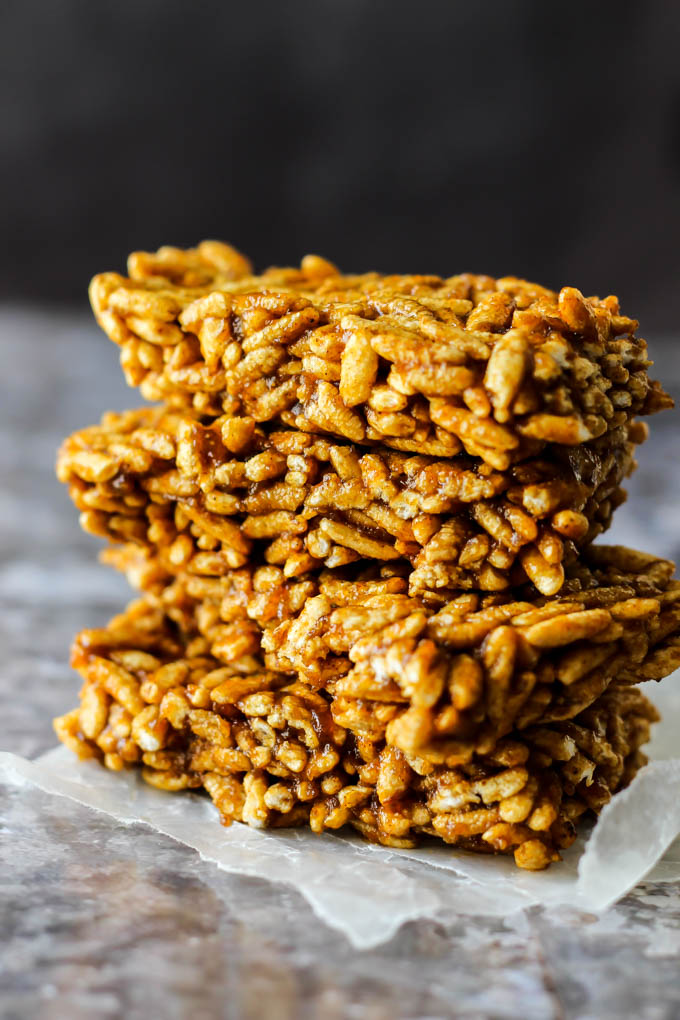 four pumpkin spice rice crispy treats stacked one on top of the other