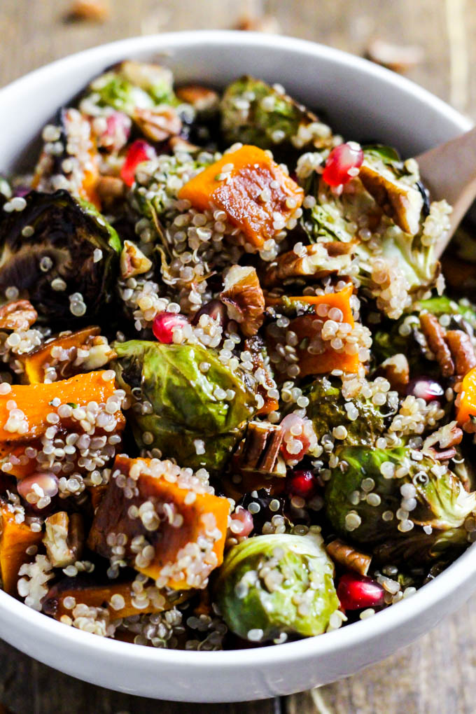 a quinoa salad with fall veggies topped with pecans