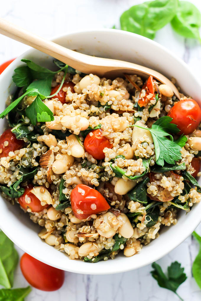 Complete your dinner with this Easy Quinoa Salad with Tomatoes & Spinach as a healthy side dish! It's vegan, gluten-free, and also makes a great lunch.