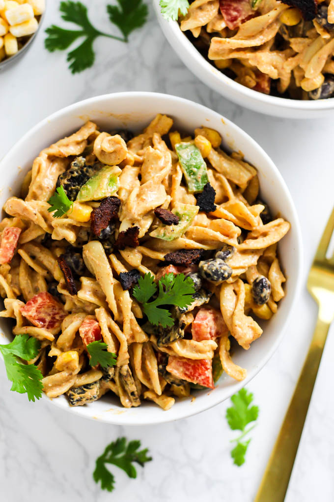a bowl of Mexican-inspired pasta salad with a cashew cream sauce