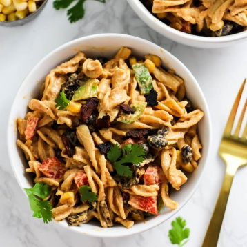 a bowl of mexican inspired pasta salad topped with cilantro