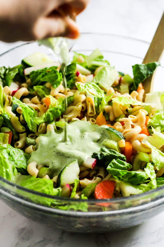 With crunchy vegetables, hearty pasta & creamy hemp ranch, this Vegan Pasta Salad is an easy dinner that's easily packable for lunch! Vegan & gluten-free.