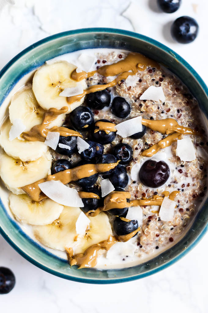 Want to change up your morning bowl of oats! Make this Breakfast Quinoa Bowl instead! It's creamy, satisfying, and perfect with any toppings you want. Vegan!