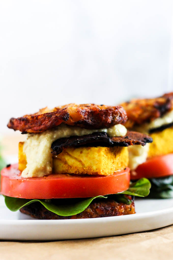 This Vegan Waffle Breakfast Sandwich is the ultimate brunch recipe to please everyone! It's loaded with hash browns, vegan bacon & dairy-free cheese. (gluten-free)