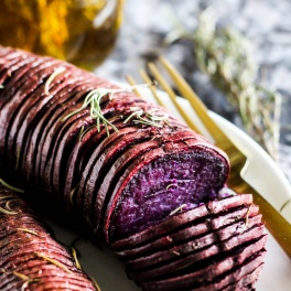 Need an exciting way to cook potatoes for dinner? These Purple Hasselback Sweet Potatoes are your new favorite side dish. Plus an infused olive oil recipe! (vegan & gluten-free)