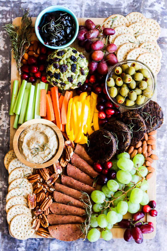 Serve this epic Vegan Charcuterie Board at your next party as a fun appetizer! Loaded with veggie meats, dairy-free cheese, fruit and vegetables.