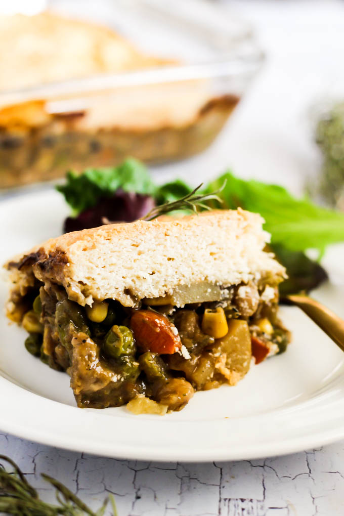 This Vegan Pot Pie will be a hit with everyone at the dinner table! It's full of chickpeas and vegetables with a fluffy biscuit topping. Made from plants!