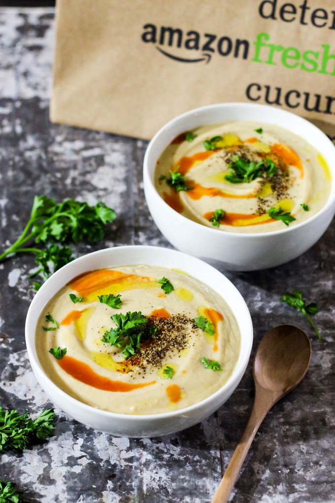 This Roasted Garlic Cauliflower Soup is a cozy bowl of wholesome ingredients that's perfect as a side dish or main meal! Vegan, gluten-free, done in 1 hour.