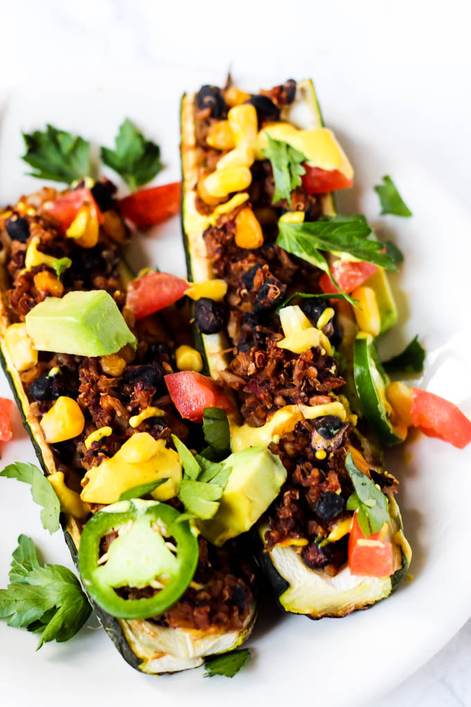 These easy Mexican Stuffed Zucchini make a balanced dinner with whole grains, vegetables & plant protein! Top with avocado & cashew cheese for more flavor.