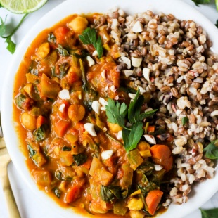 This Slow Cooker Chickpea Peanut Stew is a hands-off dinner that is full of vegetables and protein-packed chickpeas & peanuts. Easy to meal prep and freeze!
