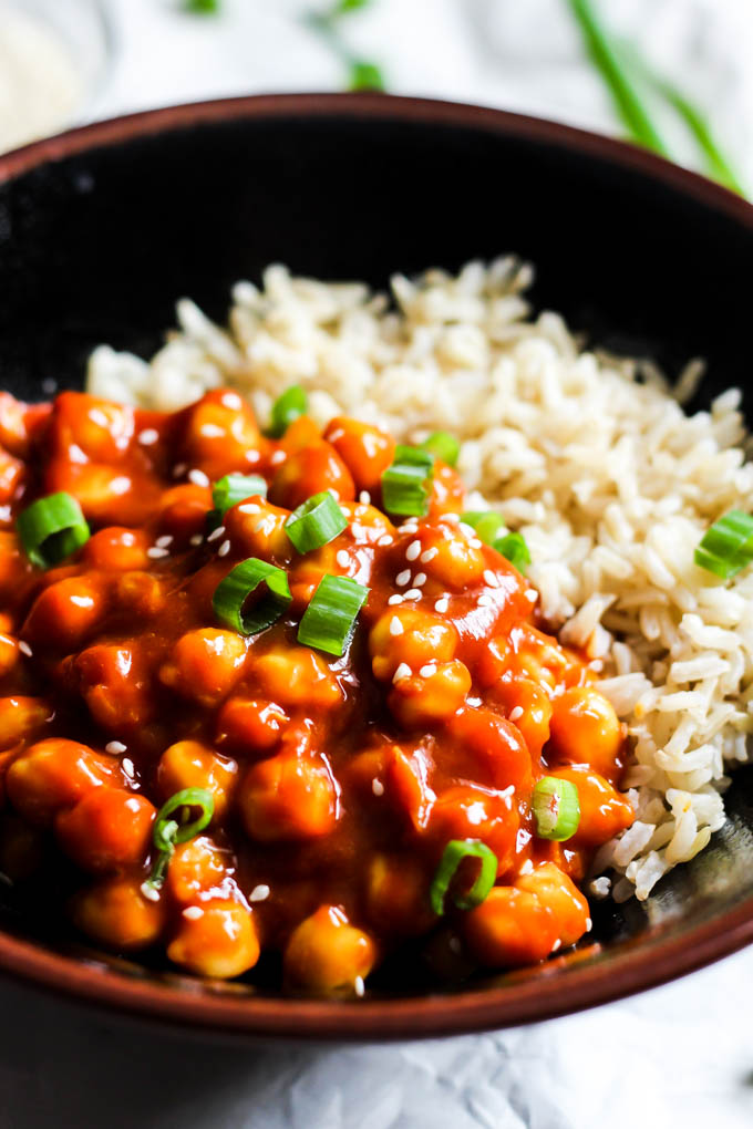 A bowl of sweet and sour chickpeas with brown rice
