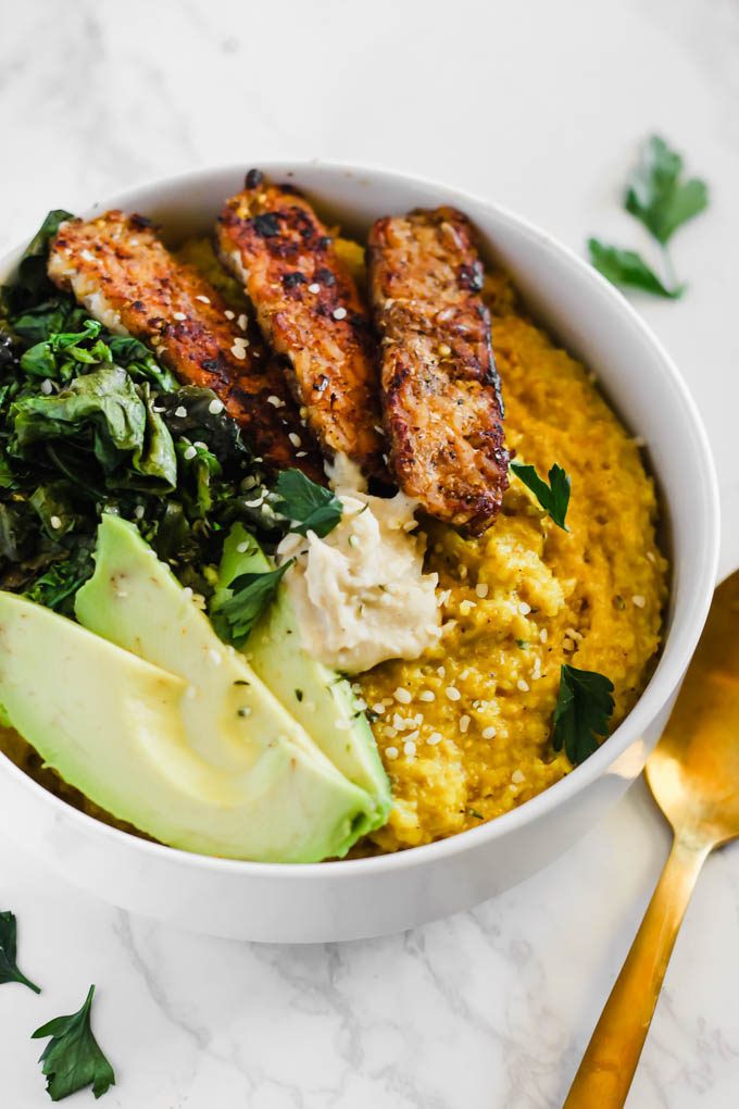 Enjoy these Savory Turmeric Oat Bowls for breakfast, lunch, or dinner as a hearty, nourishing meal! The turmeric adds an anti-inflammatory boost, and the tempeh bacon will satisfy your tastebuds.