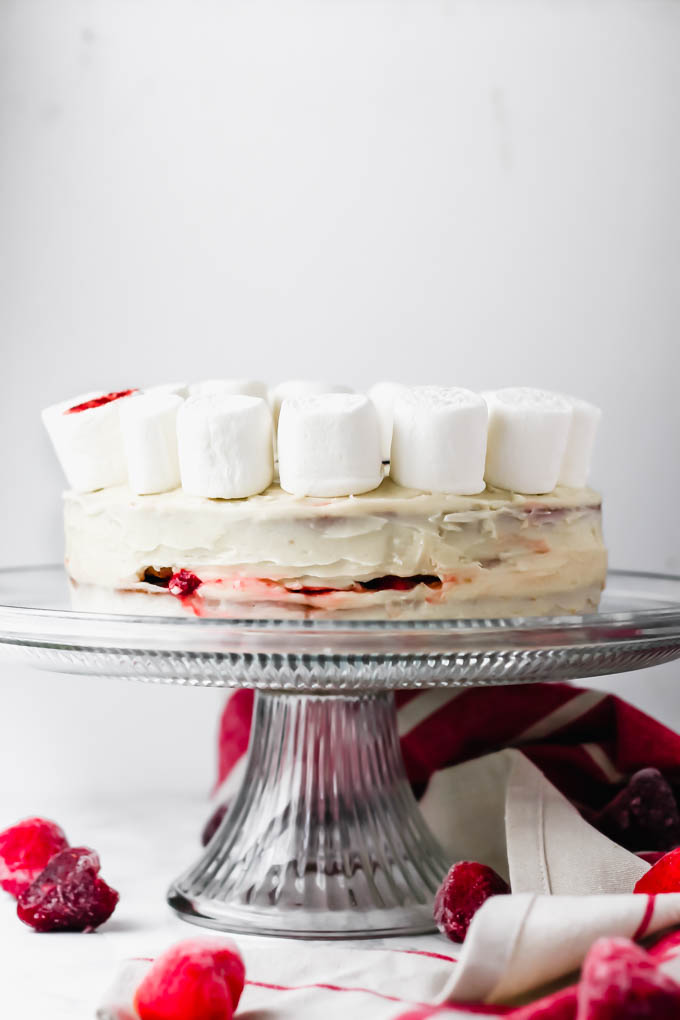 This fluffy, decadent Vegan Vanilla Strawberry Cake is perfect for any occasion—Easter, baby showers, birthday parties, you name it! To make it extra special for Easter, the cake is decorated with a marshmallow lamb.