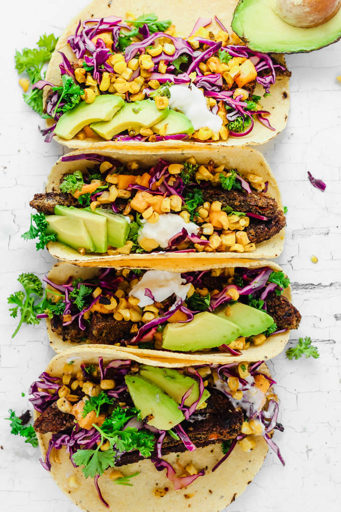 These Roasted Corn Tacos with Mango Slaw feature seasonal produce and hearty veggie burgers for a dinner recipe that comes together in under 1 hour. These will give you serious beach vibes! (vegan & gluten-free)