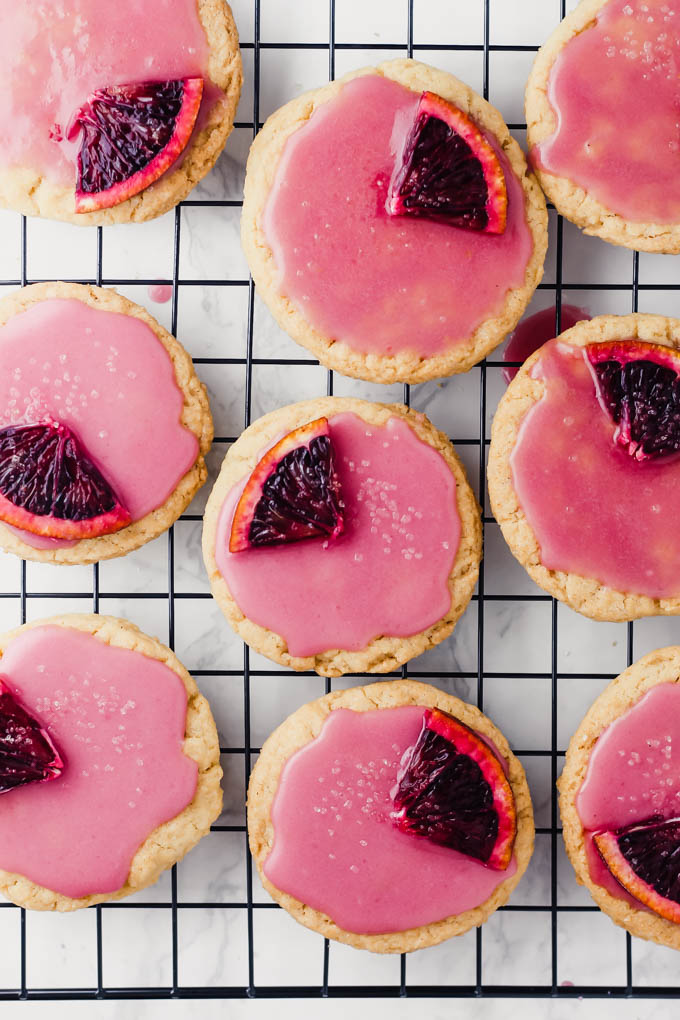 Enjoy these colorful Vegan Sugar Cookies with Blood Orange Glaze as a sweet springtime dessert! They're soft on the inside, crispy on the outside and a bit healthier thanks to olive oil.