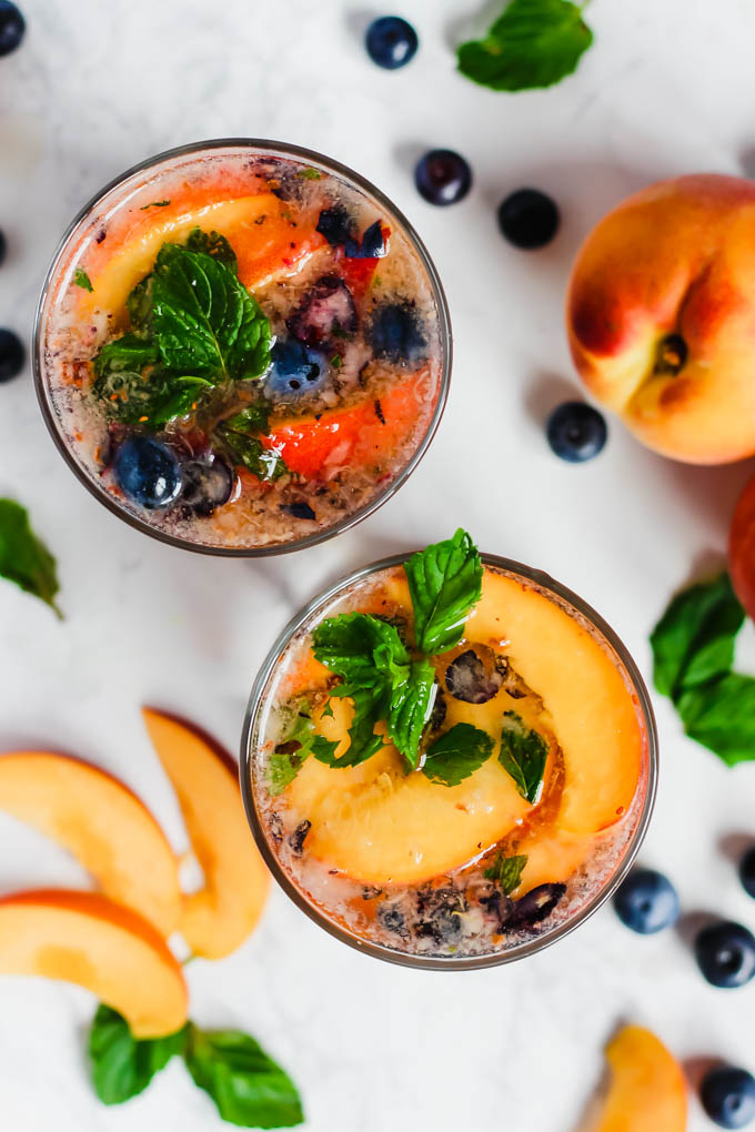 These Peach Blueberry Sangria Mocktails are packed with seasonal summer fruit for refreshing, non-alcoholic drinks for all ages to enjoy! They're infused with fresh mint and apple cider vinegar for extra flavor.