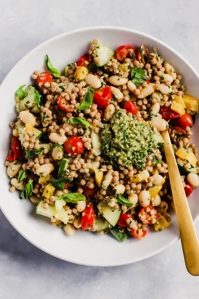 Whip up this colorful Pesto Couscous Salad for an easy lunch or dinner packed with fresh vegetables, whole grains and beans. It's done in under 30 minutes! (vegan)