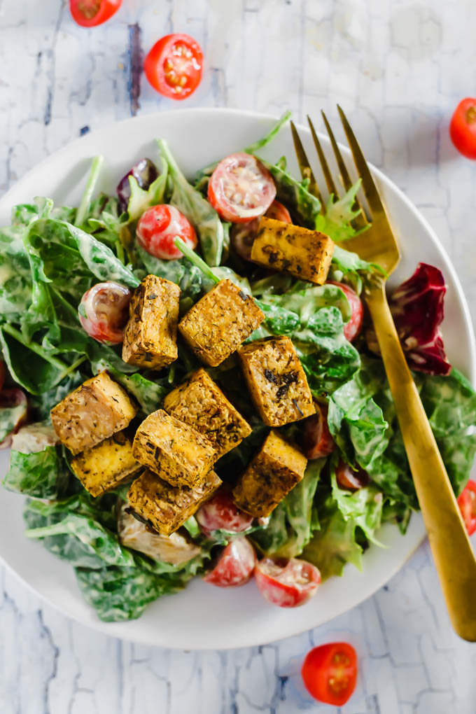 No more sad salads! This Crispy Tofu Vegan Caesar Salad is a dairy-free version of the classic dish with a tangy cashew dressing and baked tofu cubes. Serve it as a side or enjoy it for a meal. (gluten-free)