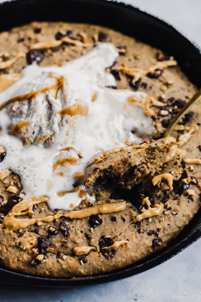 What's better than a giant cookie? A giant Chocolate Chip Peanut Butter Skillet Cookie! It's rich and fudgy, but made a bit healthier using oats and lentils. Vegan & gluten-free!