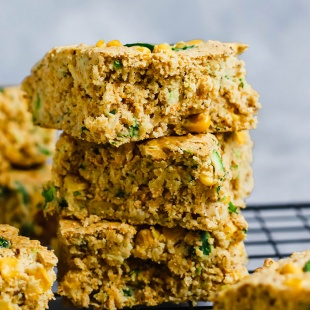 three squares of vegan cornbread stacked one on top of another
