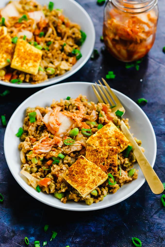 Two bowls of vegan kimchi fried rice