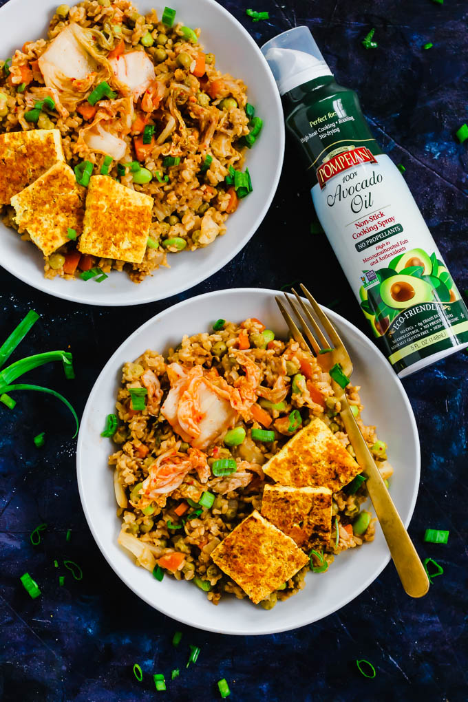 Two bowls of vegan kimchi fried rice alongside a can of avocado oil cooking spray
