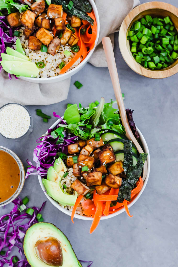 Throw together this Vegan Poke Bowl for a delicious, wholesome meal done in under an hour! It's full of savory tofu, crunchy vegetables and creamy peanut sauce. Great for meal prep! (gluten-free)