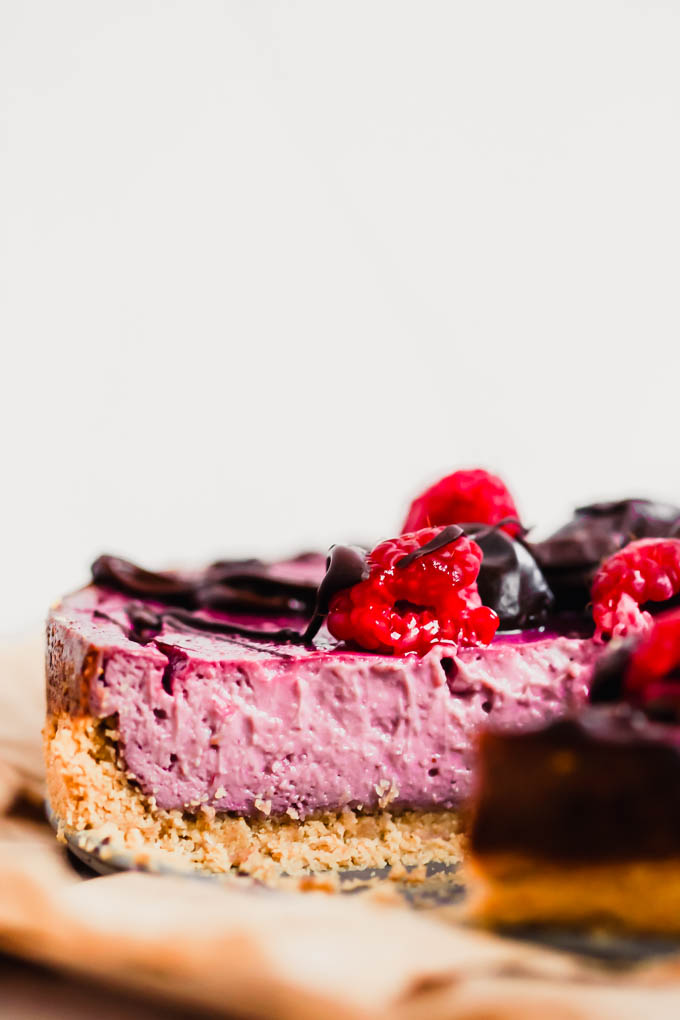 This Vegan Raspberry Cheesecake is a decadent dessert to share with the ones you love! It features a creamy, fruity filling made with a secret ingredient. (gluten-free)