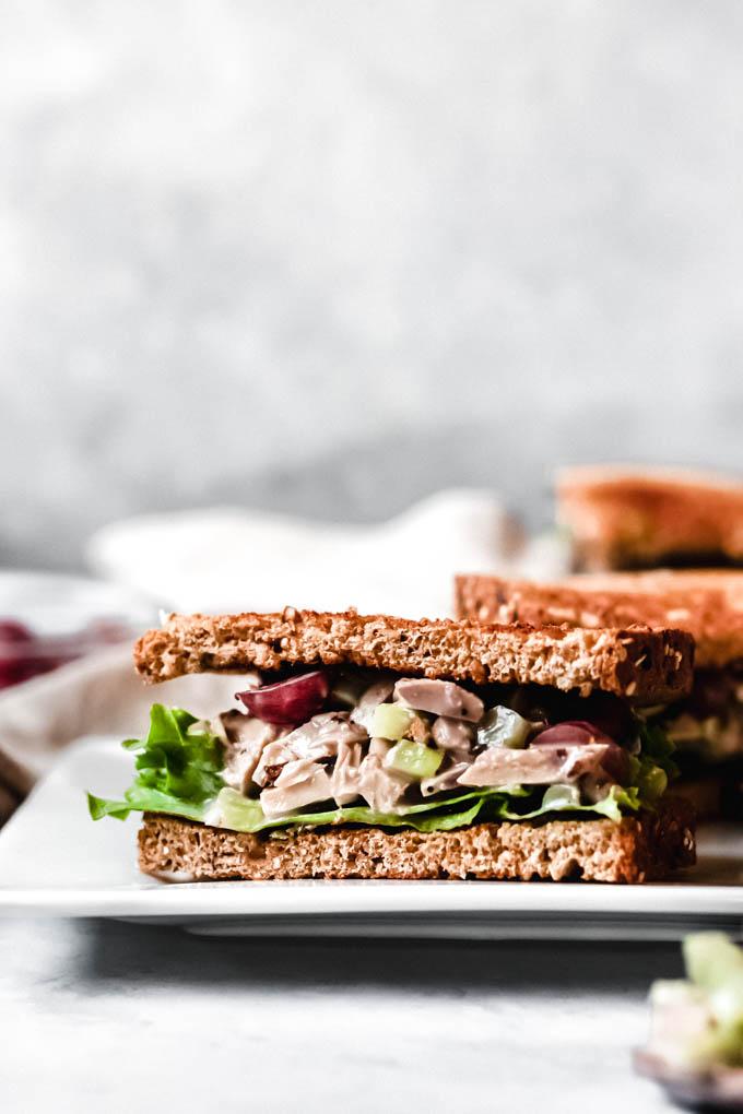 a half of a vegan chicken salad sandwich