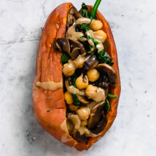 A sweet potato stuffed with sauteed spinach, mushrooms and chickpeas