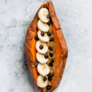 a sweet potato stuffed with sliced bananas, peanut butter and chocolate chips