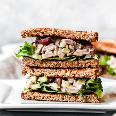 two halves of a vegan chicken salad sandwich stacked on top of one another