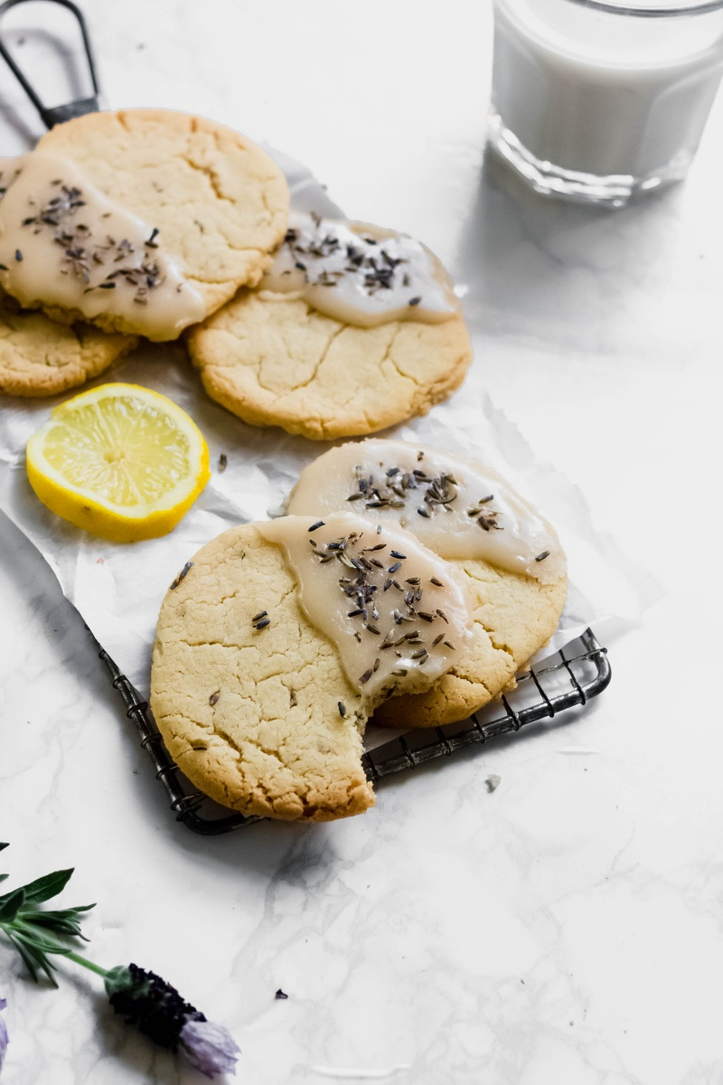 a tray of lemon lavender cookies covered in a lemon lavender glaze