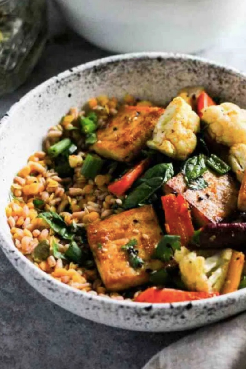 pottery bowl with rice and glazed tofu with vegetables