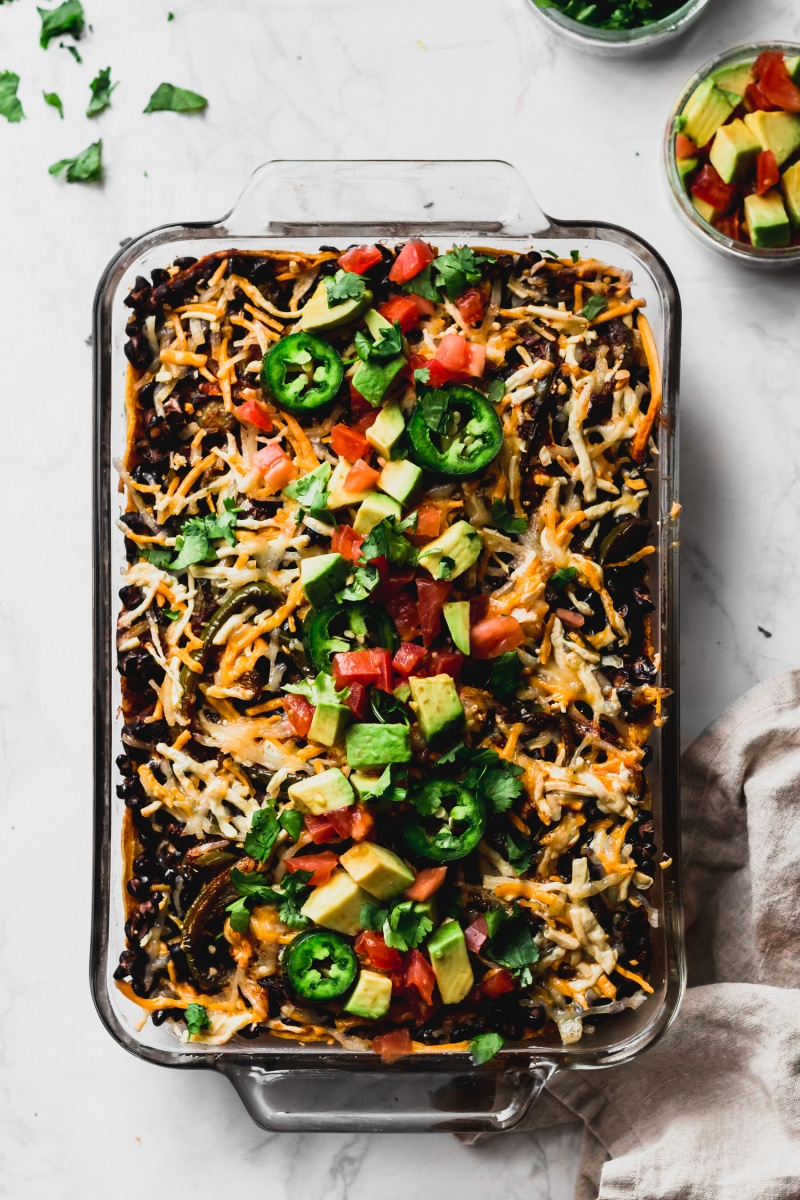 enchilada casserole with avocado and jalapeno