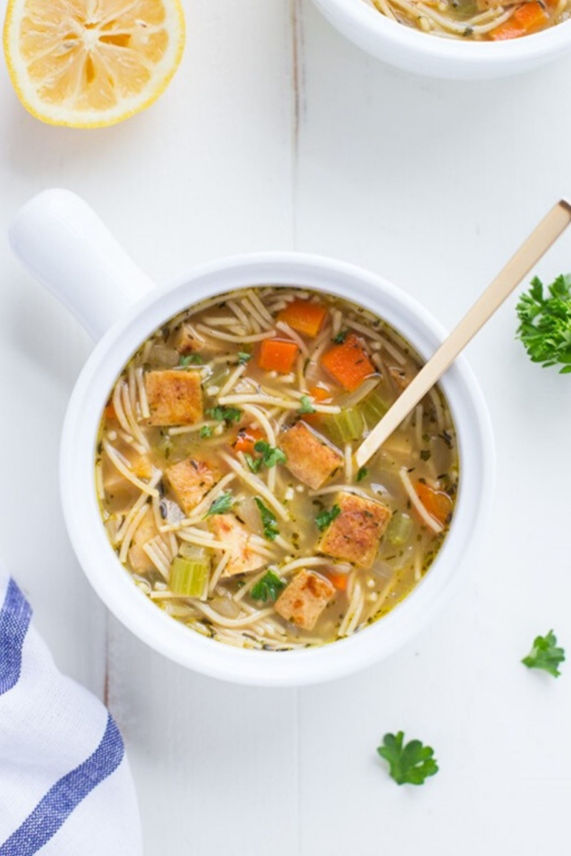 noodle soup with vegetables in a white bowl